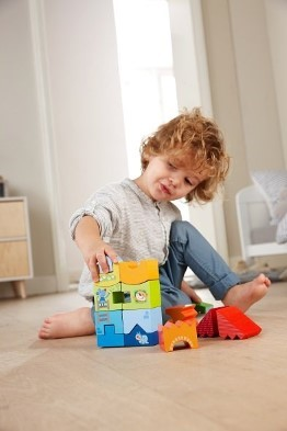 boy playing with Haba Stacking game animal High Rise