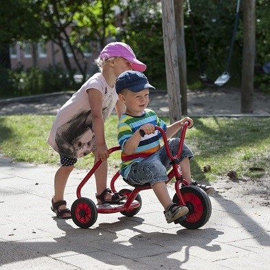 kids playing with winther ben hur trike
