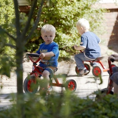 mini viking push car trike with boy playing