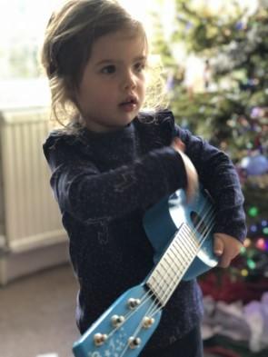 Girl Playing Toy Guitar