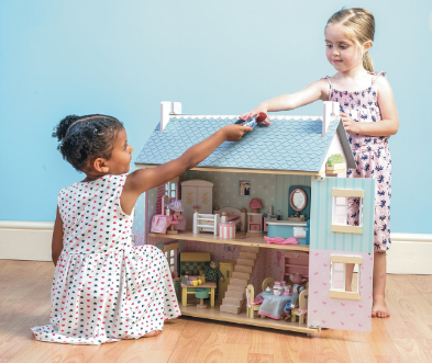 firends playing with doll house
