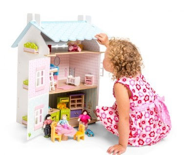playing with blue bird cottage dolls house