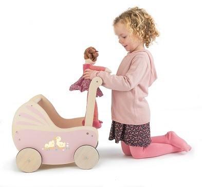 kid picking doll out of toy pram