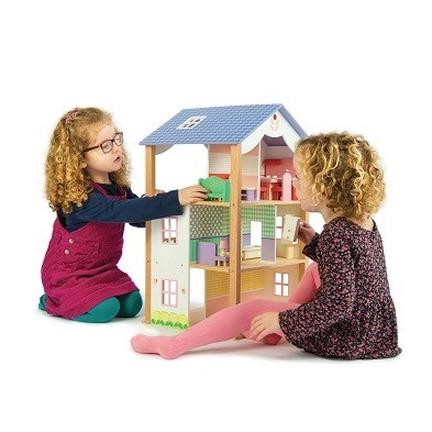two children playing with doll house