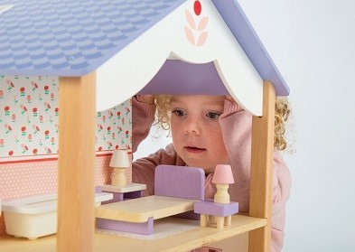 kid looking at doll house