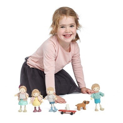 girl playing with doll set