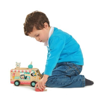 kid playing with toy van