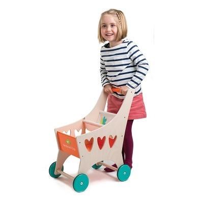 girl pushing wooden pram