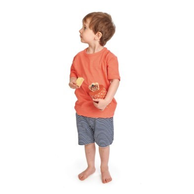 child holding biscuit tin