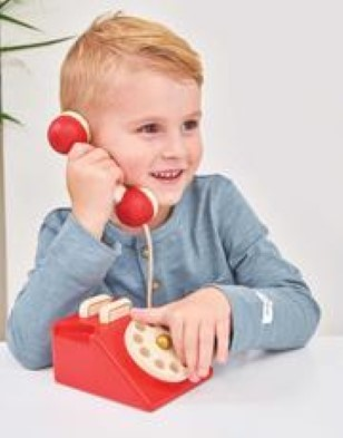 boy playing with toy phone