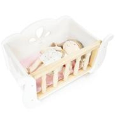 doll in cot