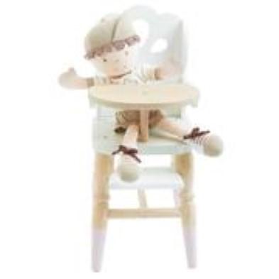 doll sitting on chair