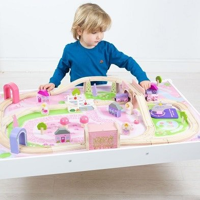 bigjigs rail magical train set and table with boy