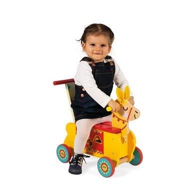 kid riding toy llama