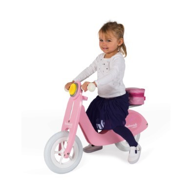 kid riding pink bike
