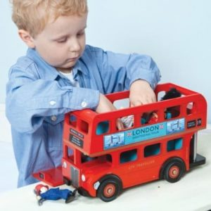boy with london bus toy